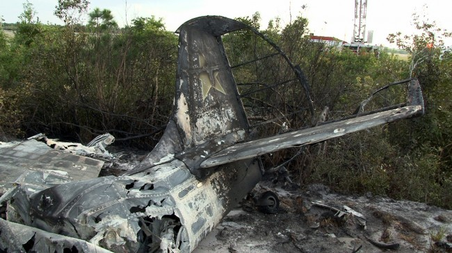 The tail end of the Yak-52 shortly after the crash. Click on the image for larger view. (© Robert Kilroy for FlaglerLive)