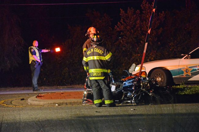 The motorcycle ended against a street sign by the median on Belle Terre, at the intersection with Ponce deLeon. Click on the image for larger view. (© FlaglerLive)