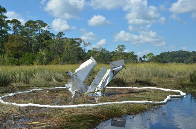 Rescuers and recovery personnel have been unable to pull Ray Miller's experimental plane from the muck in Pellicer Creek since it crashed last Friday. The plane is seen here this morning. Click on the image for larger view. (c FlaglerLive)