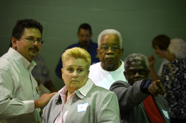 You don't want to be at the receiving end of Bunnell City Commissioner Daisy henry's pointing finger. From left, School Board member Andy Dance, Youth and Carver Center Director Cheryl Massaro, former School Board member Jim Guines, and Henry, together before the re-dedication of  Carver Gym last Saturday. (© FlaglerLive)