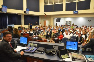 Only 210 of the more than 350 people who turned up for Monday evening's hearing on Salamander's hotel proposal could be seated in the chambers as County Commissioner Nate McLaughlin, left, got ready for the proceedings at 5:30 p.m. (© FlaglerLive)