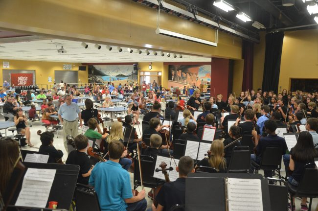 Artistic Director Sue Cryan conducting combioned orchestras at last year's Open House, as she will again on Sept. 5. Click on the image for larger view. (© FlaglerLive)