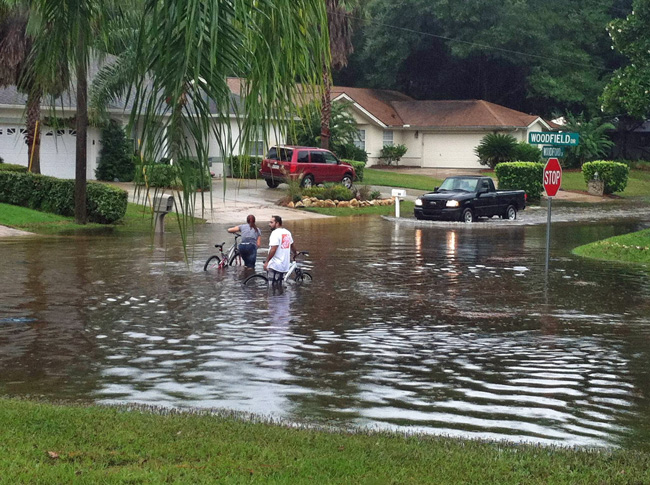 The scene on Woodfield Drive this afternoon. The W and B Sections were especially hard hit by a sudden rain event that dropped up to 4 inches in parts of Palm Coast. (© Jeff Wagner)