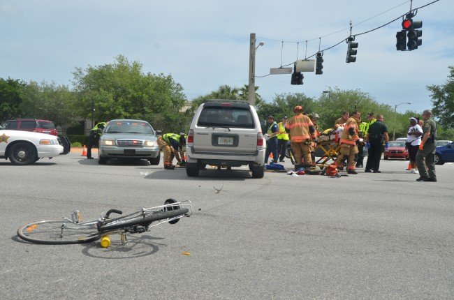 The cyclist was riding up Belle Terre when he was struck by the SUV, which was crossing from Victoria Plaza. (c FlaglerLive, click on the image for larger view)