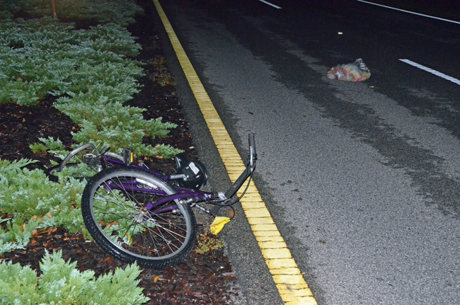 The cyclist was struck in the northbound lanes of Belle Terre Parkway this morning at around 5:40, and the bike catapulted to the median. (© FlaglerLive)