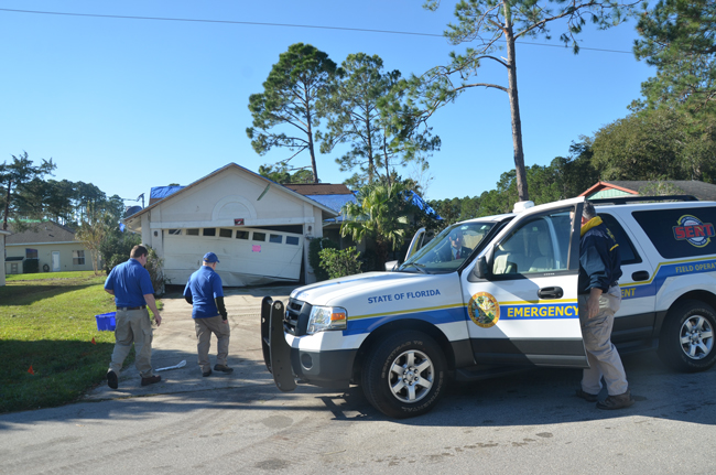 Federal and state officials arriving at Barring Place in Palm Coast Thursday morning to asses damage to homes from Saturday's tornado. The officials were to be in town most of the day. (© FlaglerLive)
