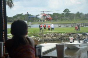 8-year-old Daniela, visiting Bings Landing with her family from South Florida, was among the spectators to an unexpected show from the deck of Captain's BBQ. Click on the image for larger view. (© FlaglerLive)
