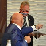 Palm Coast Council member Eddie Branquinho telling fellow-Council member Ed Danko to get away from him after the meeting today. (© FlaglerLive)