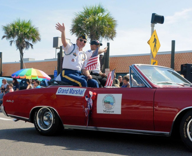 """Chapter 86 Commander and Fabulous 4th Festival """"Stars and Stripes"""" Parade Grand Marshall Raymond A. Parker, accompanied by Staff Sergeant (Ret.) Tavares Richardson, during Saturday's parade in Flagler Beach. See below for details."""