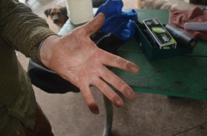 Dave Puckett shows how black his hand gets after petting his dog at the dog park, as he did on April 3. click on the image for larger view. (c FlaglerLive)