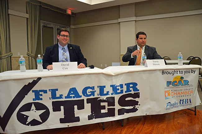 David Cox, left, the Democrat in the race for State Senate, vehemently  opposes the bill Travis Hutson is sponsoring that would allow college students 21 and older to carry concealed weapons on campus. (© FlaglerLive)