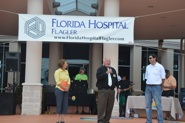 Never a limelight seeker, David Ottati, right, was widely respected and celebrated locally, as was the case at last September's 10-year anniversary of Florida Hospital at its current location, with Palm Coast Mayor Jon Netts and County Commissioner Barbara Revels, who is also a member of the hospital's board. (© FlaglerLive)