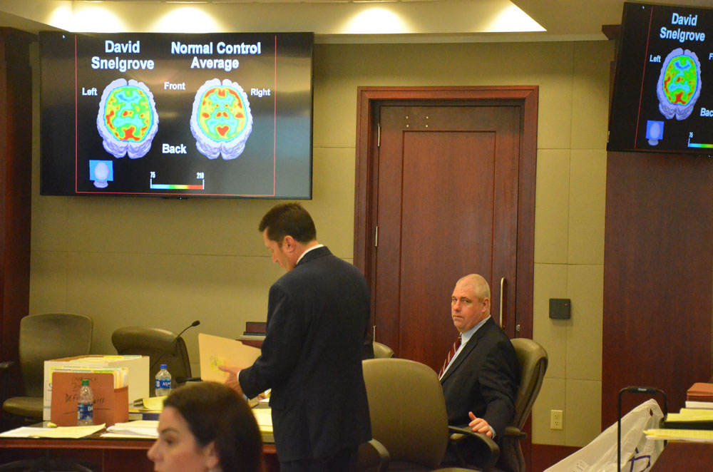 David Snelgrove's brain is at the center of the defense's strategy to ward off a death sentence for him. Snelgrove is to the right. His attorney, Michael Nielsen, is standing. (© FlaglerLive)