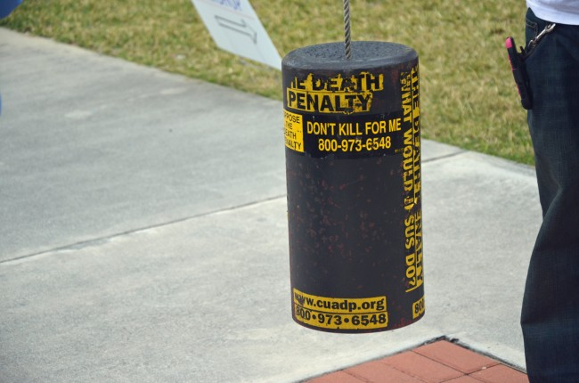 The makeshift bell that opponents of the death penalty ring during vigils at every execution in Starke, the state prison where inmates are executed. Click on the image for larger view. (© FlaglerLive)