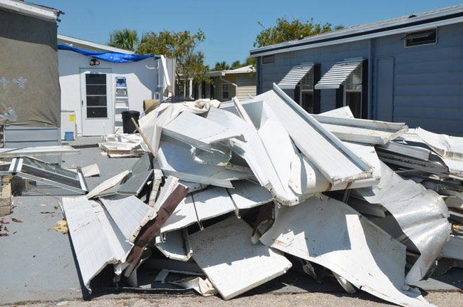 Piled up debris at Surfside Estates in Beverly Beach. (© FlaglerLive)