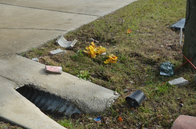 Some of the debris by the culvert investigators believe Barlow struck after the collision with the mailbox. Click on the image for larger view. (© FlaglerLive)