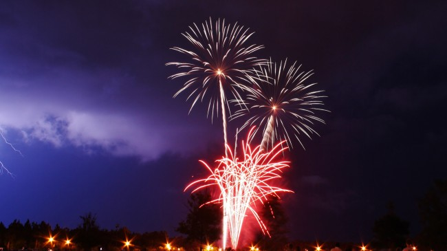 A photograph Joe Delarosby shot of the Palm Coast fireworks on July 4, 2012. Notice the lightning to the left. Click on the image for larger view. (© Joe Delarosby for FlaglerLive)