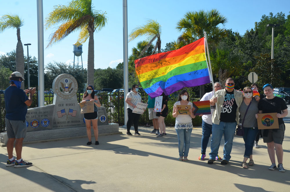 A small demonstration in support of LGBTQ rights preceded Tuesday evening's school board meeting. (© FlaglerLive)