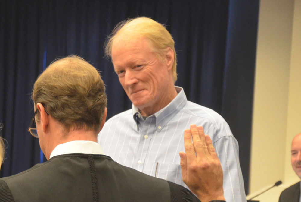 Dennis McDonald at his wife's swearing in for a school board seat four years ago, as a circuit judge was administering the oath. (© FlaglerLive)
