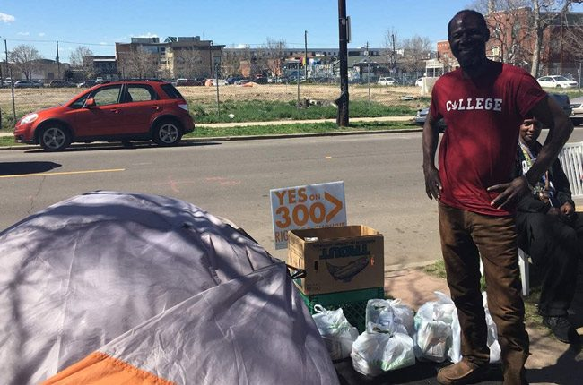 """Jerry Burton, 57, stands beside his tent in downtown Denver. A ballot question before Denver voters next week, an initiative called """"Right to Survive,"""" would make sleeping on the streets easier. (Pew Charitable Trust)"""