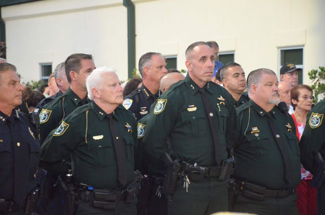 The sheriff's Chief Mark Strobridge, second from left, seen here at last May's memorial for law enforcement officers, presented the sheriff 's pitch for additional deputies to the Palm Coast City Council this morning. (© FlaglerLive)