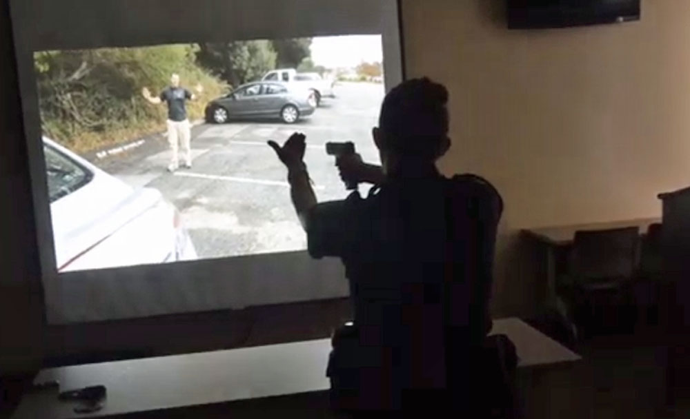 Flagler County Sheriff's deputy Kathryn Gordon instructing an armed suspect in a simulated  exercise testing deputies' split-second judgments. (© FlaglerLive)