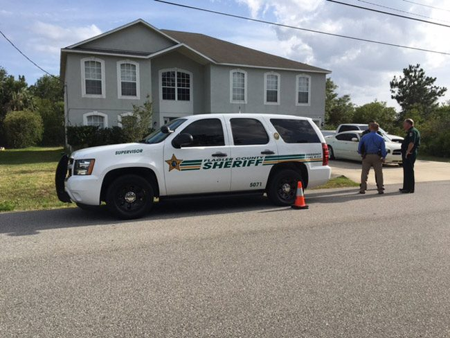 The Flagler County Sheriff's Sergeant's patrol car was shot at, with at least two bullets striking the vehicle. (FCSO)