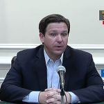 Gov. Ron DeSantis at his afternoon summary briefing on the coronavirus this afternoon. He had refused to impose more stringent lockdown orders across Florida as Covid-19 cases have surged. (© FlaglerLive via Florida Channel)
