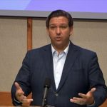 Gov. Ron DeSantis addressing reporters today in Pensacola in a still from a WFLA video posted on the Governor's Facebook page.