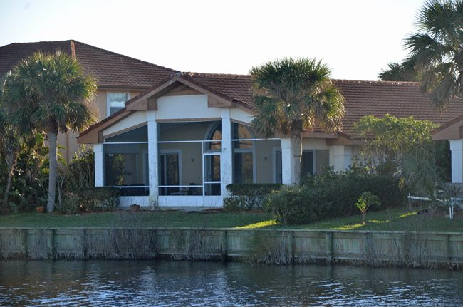 The DeSantis house he's owned at Lakeside b y the Sea since October 2016, from where, a neighbor said, a huge TV would reflect against the lake and stay on all night, though DeSantis appeared not to be in the house. The property went up for sale earlier this week. (© FlaglerLive)