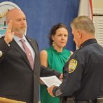 kyle totten Bunnell Police Chief Tom Foster last week swore in Detective Kyle Totten, as his wife, County Judge Andrea Totten, stood by his side--months after roles were reversed, when husband stood at his wife's side during her investiture for county judge.