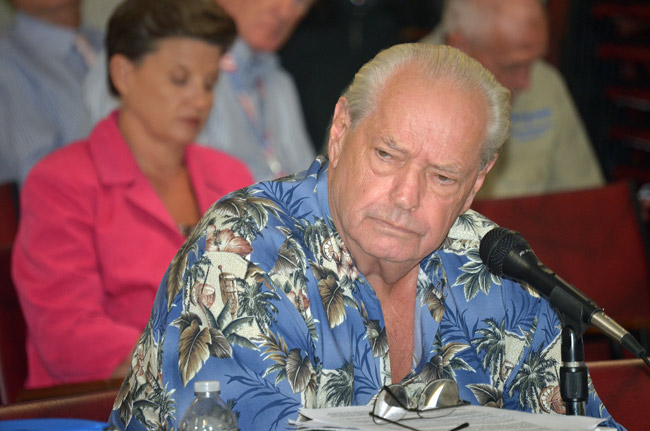 Dick Holmberg during his appearance before a joint panel of three Flagler government agencies today. (© FlaglerLive)