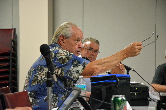 Dick Holmberg, explaining his technology to Flagler County and Flagler Beach officials last July, as Flagler Beach City Manager Brice Campbell looked on. (© FlaglerLive)