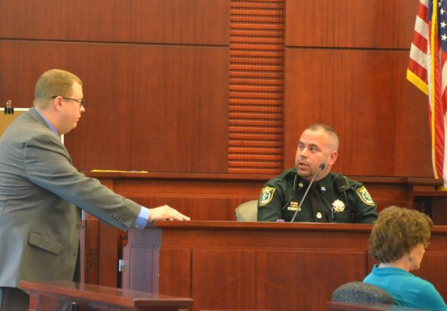 Flagler County Sheriff's deputy Diego Gonzalez, 32, being cross-examined by Assistant State Attorney Mark Lewis today, was sworn in in September 2015. (© FlaglerLive)
