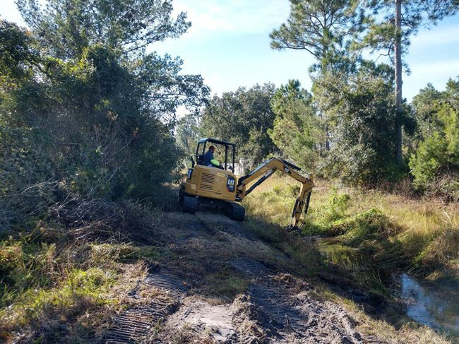 Ditch maintenance on Fellowship Drive in Palm Coast.