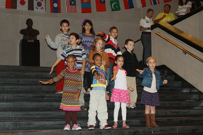 Children ages 6 to 10 performing 'God Bless America' in sign language at the an annual Diversity Day Observance at Eisenhower Hall, West Point. The observance included performances by the Cadet African-American Arts Forum, Native American Tribal Dance, Cadet Combat Salsa Club along with food samplings from various cultures. The theme was 'Diversity: The Road to Readiness.' (Kathy Eastwood)
