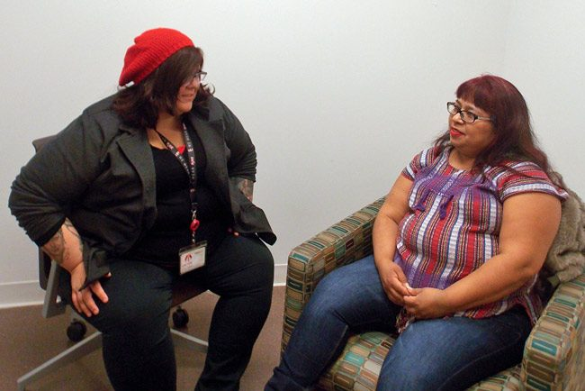 Fanny Ortiz (right), who left an abusive marriage after nearly a decade, meets weekly with therapist Brittany Martinez at the East Los Angeles Women's Center. The office is located on the campus of the Los Angeles County-USC Medical Center. (Anna Gorman/KHN)