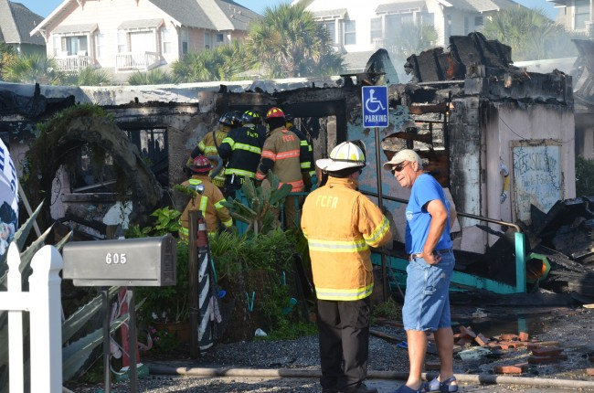 Flagler County Fire Chief Don petito and Flagler Beach City Manager Bruce Campbell at the scene. Click on the image for larger view. (© FlaglerLive)