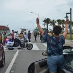 "A woman taking the ""don't shoot"" stand in solidarity with marchers protesting police brutality in Flagler Beach last week. (© FlaglerLive)"