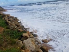 Hurricane Dorian's early message to Flagler Beach was lapping at the rock revetment the Department of Transportation put down after Hurricane Matthew in 2016. Dorian's storm surge and waves are expected to cause some impact to the shoreline. (c Charles Knirk for FlaglerLive)