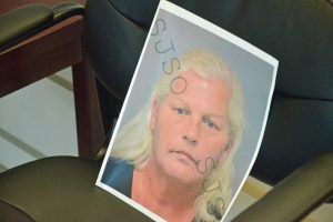 A mugshot of Dorothy Singer the Sheriff's Office printed out from the St. Johns County Sheriff's jail, as it was propped up on a chair during today's news conference. Click on the image for larger view. (© FlaglerLive)