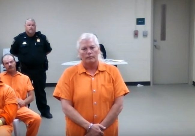 Dorothy Singer, accused of murdering her husband Charles execution-style, has not deigned appear in court in person. She is seen here at her first appearance hearing, by video feed from the Flagler County jail, where she's been since her arrest on May 9, 2017. (© FlaglerLive)
