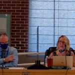 Kathleen Doyle, Flagler Beach's long-time finance director, and Matt Doughney, the police chief sitting in as interim manager during the commission's third day-long budget workshop last week. (© FlaglerLive via YouTube)