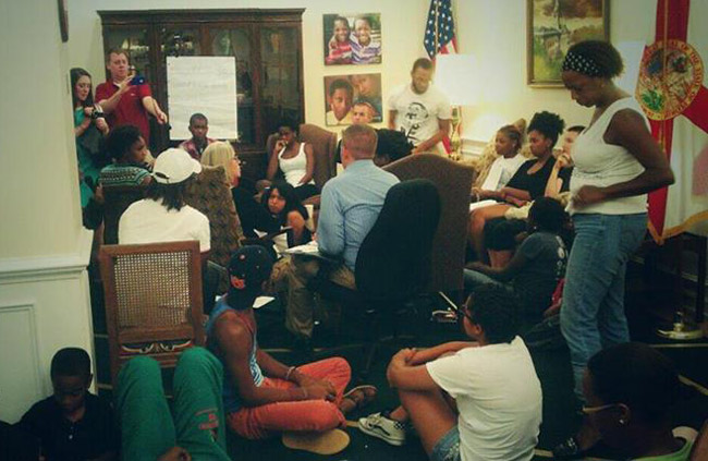 The head of the Florida Department of Juvenile Justice hearing it from Dream Defenders in the governor's office. (Facebook)