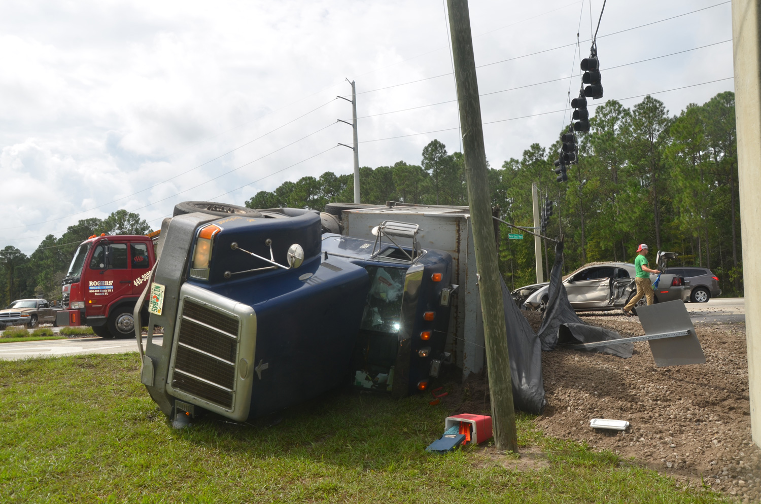 dump truck overturns in collision on palm coast parkway and us1