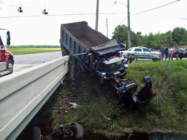 The dump truck, post-swerving. Click on the image for larger view. (© Elbert Tucker for FlaglerLive)