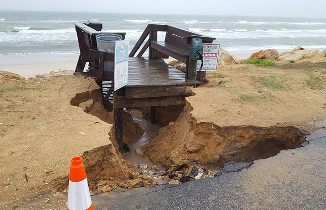 The rainstorm excavated the dune from under the walkover at South 20th Street in Flagler Beach. (© Ed Siarkowicz)