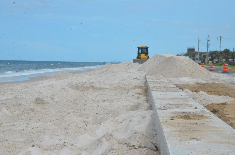 A Flagler Beach commissioner is hoping that sand dredged for the U.S. Army Corps of Engineers project in the city will be used to re-bury the sea wall built a year and a half ago at the north end of town. (© FlaglerLive)