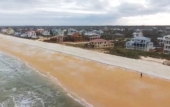 The new runway-like layer of dunes, its sand quality distinctly whiter than existing sand, lines the edge of the beach in a capture from Chris Goodfellow's drone.