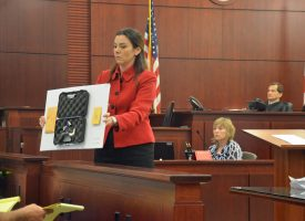 Assistant State Attorney Jennifer Dunton shows the jury the five-shot revolver, a .22-caliber Magnum, which the prosecution says is the murder weapon. click on the image for larger view. (c FlaglerLive)